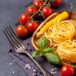 Dry pasta with tomato, basil and pepper — Stock Photo #34756471