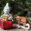 Christmas card with snowman and gifts — Stock Photo