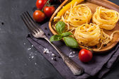 Dry pasta with tomato, basil and pepper — Stock Photo