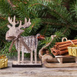 Christmas card with cinnamon and deer — Stock Photo