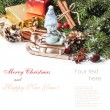 Christmas card with snowman on sled — Stock Photo #35242635