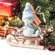 Christmas card with snowman on sled — Stock Photo #35243387