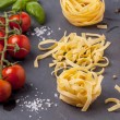 Dry pasta with tomatoes, basil and pepper — Stock Photo #35244399