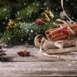 Christmas card with sled and cinnamon — Stock Photo #35244417