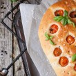 Italian focaccia bread with tomatoes — Stock Photo