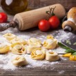 Pasta ravioli on flour — Stock Photo