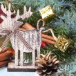 Christmas card with wooden deer — Stock Photo