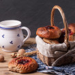 Basket of buns and cup od milk — Stock Photo