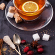 Cup of tea with sugar and spices — Stock Photo