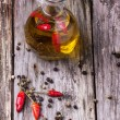 Olive oil with chili peppers — Stock Photo #36654067