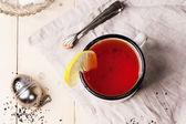 Vintage mug of tea — Stock Photo