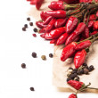 Red hot chili peppers over white — Stock Photo #37108757