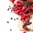 Red hot chili peppers over white — Stock Photo