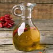 Olive oil with chili peppers — Stock Photo #37108799