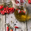 Olive oil with chili peppers — Stock Photo #37108887