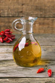 Olive oil with chili peppers — Stock Photo