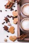 Tow cup of cappuccino with cookies as hearts — Stock Photo