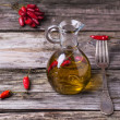Olive oil with chili peppers — Stock Photo #37443891