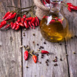 Olive oil with chili peppers — Stock Photo #37443899