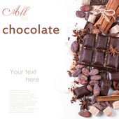 Dark chocolate with cocoa beans — Stock Photo