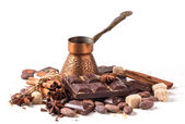 Copper cezve with dark chocolate and cocoa beans — Stock Photo