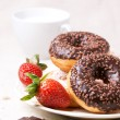 Постер, плакат: Chocolate donuts with fresh strawberries