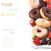 Set of donuts with fresh strawberries — Stock Photo