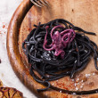 Black spaghetti with octopus — Stock Photo #41259869