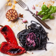Black spaghetti with grilled vegetables — Stock Photo