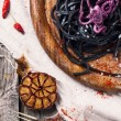 Black spaghetti with octopus — Stock Photo #41437239