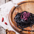 Black spaghetti with octopus — Stock Photo #41489353