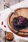Black spaghetti with octopus — Stock Photo