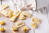 Pasta ravioli on flour — Stock Photo