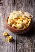 Pasta ravioli in wooden bowl — Stock Photo