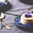 Caramel pannacotta with violet flowers — Stock Photo