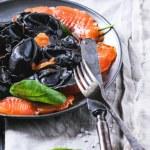Black ravioli with salted salmon — Stock Photo #44745139