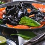 Black ravioli with salted salmon — Stock Photo #44745143