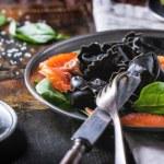 Black ravioli with salted salmon — Stock Photo #45149109