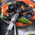 Black ravioli with salted salmon — Stock Photo #45149317