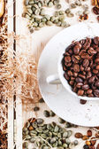 Green, brown and black coffee beans — Stock Photo