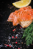 Bread with salted salmon — Stock Photo