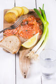 Snack with salted salmon — Stock Photo
