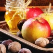 Honey, nuts and apples — Stock Photo