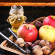 Honey, nuts and apples — Stock Photo #50873689