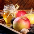 Honey, nuts and apples — Stock Photo #50873691