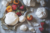 Meringue with apricots and strawberries. — Stock Photo