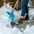 Woman removing snow — Stock Photo