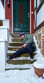 Man slip on snow covered stairs — Stock Photo