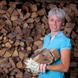 Stock Photo: Womwith fire wood