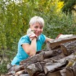 Woman with fire wood — Stock Photo #20068301